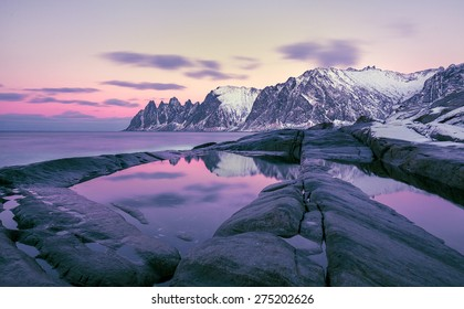 Winter view to the Steinfjord on Senja Island in the sunset, Oksan on background -  Troms county, Norway (long exposure)