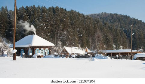 Winter view of the taiga village in the early morning