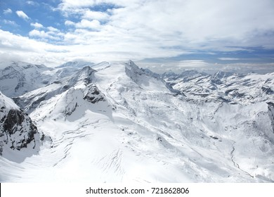 Winter view from the top of Kitzsteinhorn mountain, Kaprun ski resort, National Park Hohe Tauern, Austrian Alps, Europe.