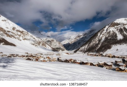 Winter view from the top on Livigno city and lake Livigno. Italy.