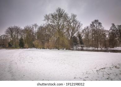 winter view of the white Vondelpark under the snow in Amsterdam