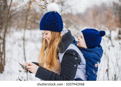 Winter walk, Mother with two boys, babywearing