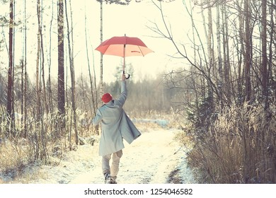 winter walk with an umbrella / man in a coat with an umbrella, walk against the backdrop of the winter landscape, winter view