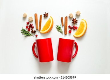 Winter warmer drink concept, two cups with warming alcohol cocktail recipe ingredients, winter holidays drink, flat lay, view from above