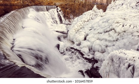 Winter water falls with ice build up.  Photograph of the Yantic Falls in Norwich CT, taken in January along the Yantic river.