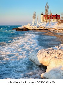 Winter waves and an cy Point Betsie Lighthouse. A windy Lake Michigan evening.