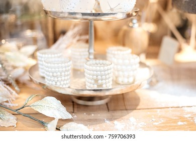 Winter wedding details on a wooden table.