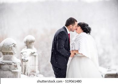 Winter wedding kiss of bride and groom