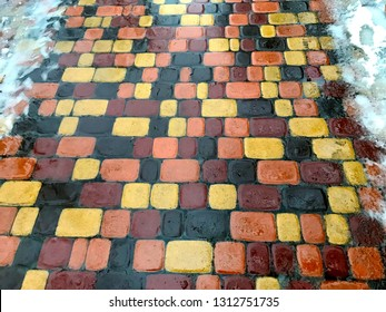 Winter wet pavement colorful patchwork style.