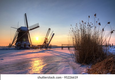 winter windmill at sunset between Abcoude and Baambrugge in the Netherlands, near Amsterdam