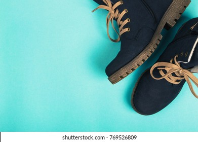 Winter woman boots on a blue background. Winter concept