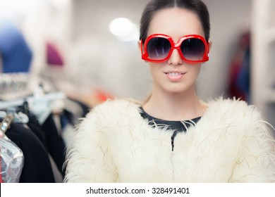 Winter Woman in Fur Coat with Big Sunglasses - Fabulous diva in fashion store wearing oversized glasses and fur jacket