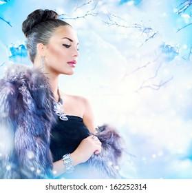 Winter Woman in Luxury Fur Coat. Beauty Fashion Model Girl in Blue Fox Fur Coat. Beautiful Luxury Winter Lady