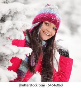 winter woman play snowballs