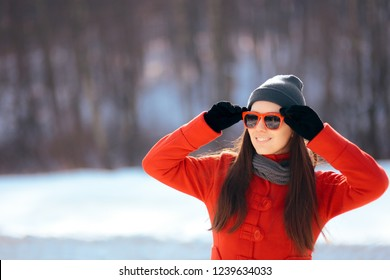 Winter Woman Wearing Sunglasses Outdoors. Cool girl enjoying holiday vacation outside in nature