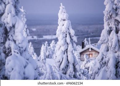 Winter wonderland in finnish Lapland. Cabin in the woods. Landscape photo. Wintry scenery from Lapland. Iso-syöte, Pudasjärvi, Finland.