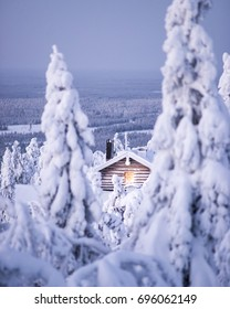 Winter wonderland in finnish Lapland. Cabin in the woods. Wintry scenery from Lapland. Iso-syöte, Pudasjärvi, Finland. Portrait photo.