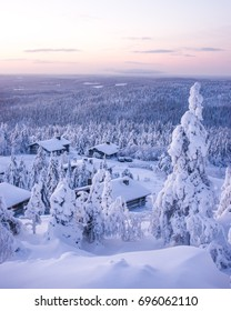 Winter wonderland in finnish Lapland. Cabins on the hill. Wintry scenery from Lapland.