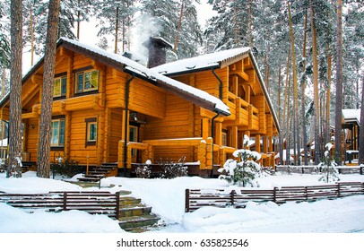 Winter wooden cottage house