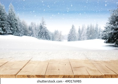 winter wooden table of snow and landscape of trees