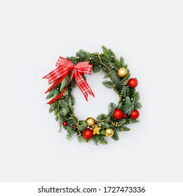 Winter wreath of pine needles decoration red and golden Christma