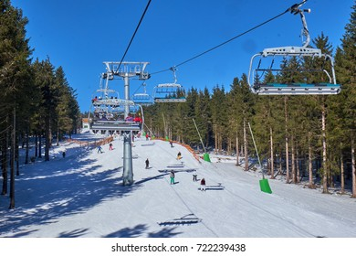 WINTERBERG, GERMANY - FEBRUARY 14, 2017: People on skis seen from up high in a chairlift at Ski Carousel Winterberg