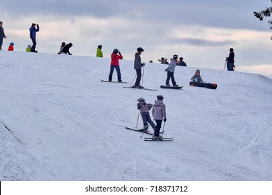 WINTERBERG, GERMANY - FEBRUARY 16, 2017: Many people on skis and snowboards on a mountain top at Ski Carousel Winterberg