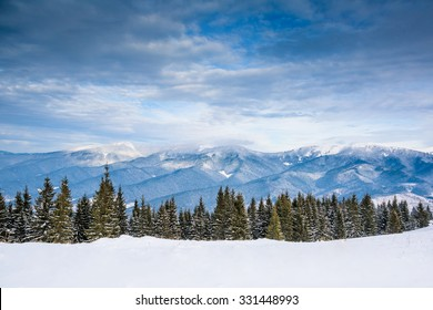 Winter/Christmas background with mountains and trees