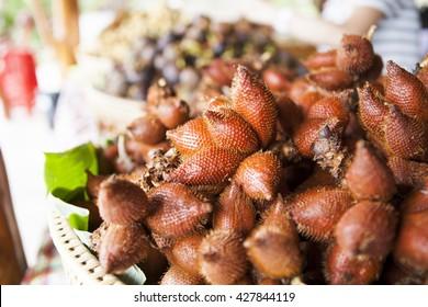 Wintergreen in basket, wintergreen is a fruit in tropical zone.