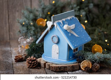 Winter's Tale. Christmas magic and homeliness. Gingerbread house. Copy of space.