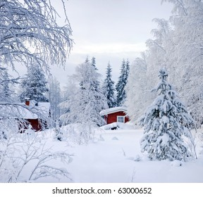 Winter's Tale. Red Finnish cottage in a beautiful snow forest.