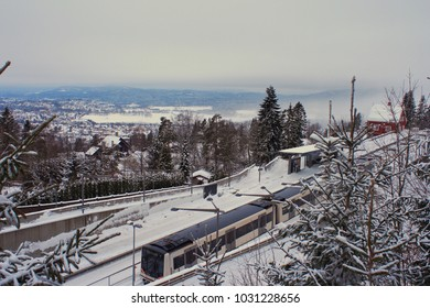 winterscape near Oslo, Norway. train station beyond the city
