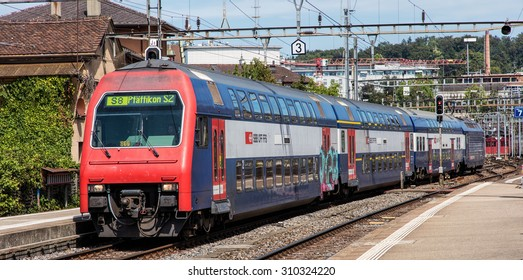 Winterthur, Switzerland - 26 August, 2015: train heading to Pfaffikon arriving to the Winterthur main railway station, which is the principal railway station in the city of Winterthur.