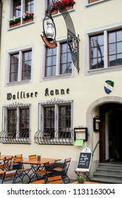 WINTERTHUR, SWITZERLAND - JUNE 28, 2018: Vertical image of facade of Walliser Kane restaurant in Steinberggasse in the city centre with tables and chairs outside.