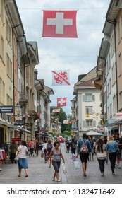 WINTERTHUR, SWITZERLAND - JUNE 28, 2018: View down pedestrianised Marktgasse towards city centre with Swiss and Winterthur flags,