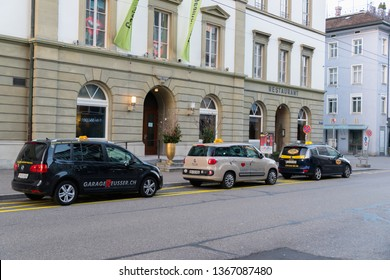 Winterthur, Switzerland - March 24, 2019 : Taxis park in Winterthur waiting for customers in the city center on a morning winter day