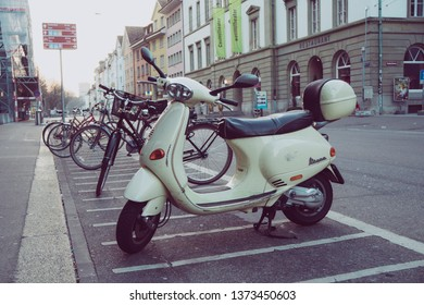 Winterthur, Switzerland - March 24, 2019 :Vespa. Classical white Italian scooter by Piaggo stands parked in Winterthur, Switzerland