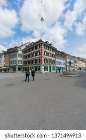 Winterthur, ZH / Switzerland - April 8, 2019: the hustle and bustle in the old town of Winterthur with people running errands and shopping
