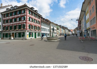 Winterthur, ZH / Switzerland - April 8, 2019: the hustle and bustle in the old town of Winterthur with people riding their bicycles in the foreground