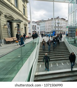 Winterthur, ZH / Switzerland - April 8, 2019:  Winterthur train station and trains leaving with commuters and people hurrying to their trains