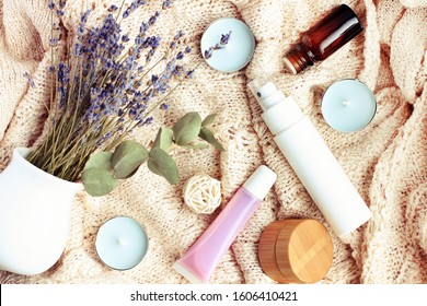 Wintertime homemade cosmetics, autumn spa, natural beauty care products & aromatherapy, relaxing top view background with dried lavender flowers over woolen blanket