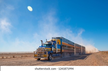 Winton, Queensland / Australia - June 18 2018: Seen are Roadtrains travelling down outback roads near the town of Winton in  the Queensland outback