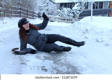 Wintry accident on smooth streets. A woman has slipped on the street