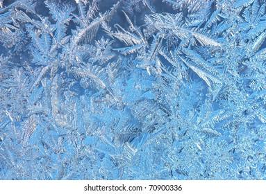 Wintry hoarfrost background on a window