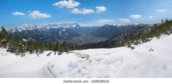 wintry landscape at Wank mountain, view to Zugspitze and tourist resort Garmisch-Partenkirchen, upper bavaria