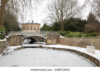 Wintry view of the Kennet and Avon Canal in Sydney Gardens, Bath, England during the big freeze at the beginning of March 2018.