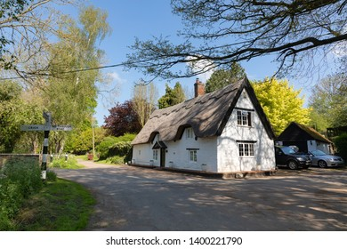 Winwick, Northamptonshire / UK - May 16th 2019: Bridge Cottage, a picturesque, Grade II listed, thatched building standing at a crossroads in a small and pretty village.