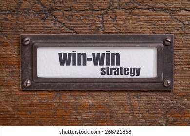 win-win strategy  - file cabinet label, bronze holder against grunge and scratched wood