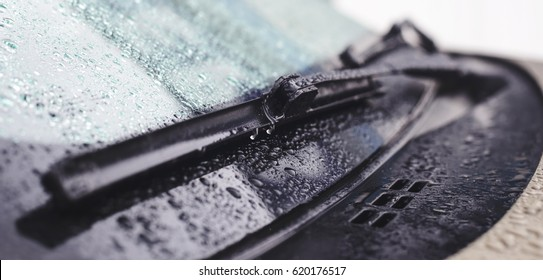 Wiper blade and water droplets on the car glass with shallow depth of field