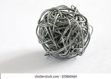 wire ball on white background - Depth of field close up photo